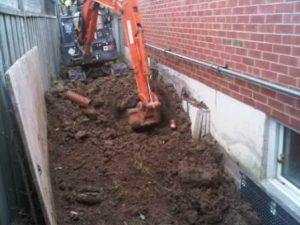 Excavated foundation of newer home