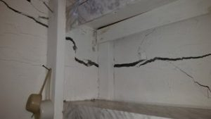 Significantly cracked cinder block foundation wall