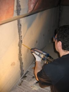 Epoxy injection of leaking foundation crack