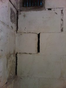 Cinder-blocks that have shifted with deteriorated mortar joints