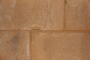 Minor hairline cracking in cinder-block foundation wall