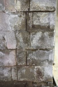 Stained and wet cinder block foundation