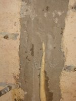 Polyurethane expanding out of homeowner crack repair