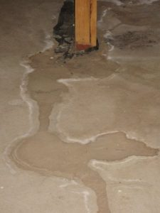 water stained basement floor