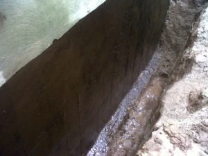 Basement foundation waterproofed with an elastomeric rubber coating