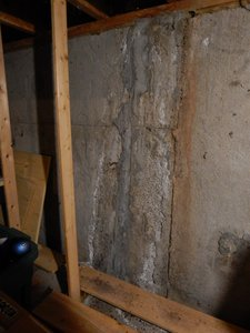 Foundation crack covered with hydraulic cement